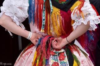 Girl in Hungarian folklore dress at Holloko Easter festival in Hungary
